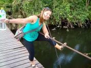 Megan demonstrating the potential hazards of the rope bridge